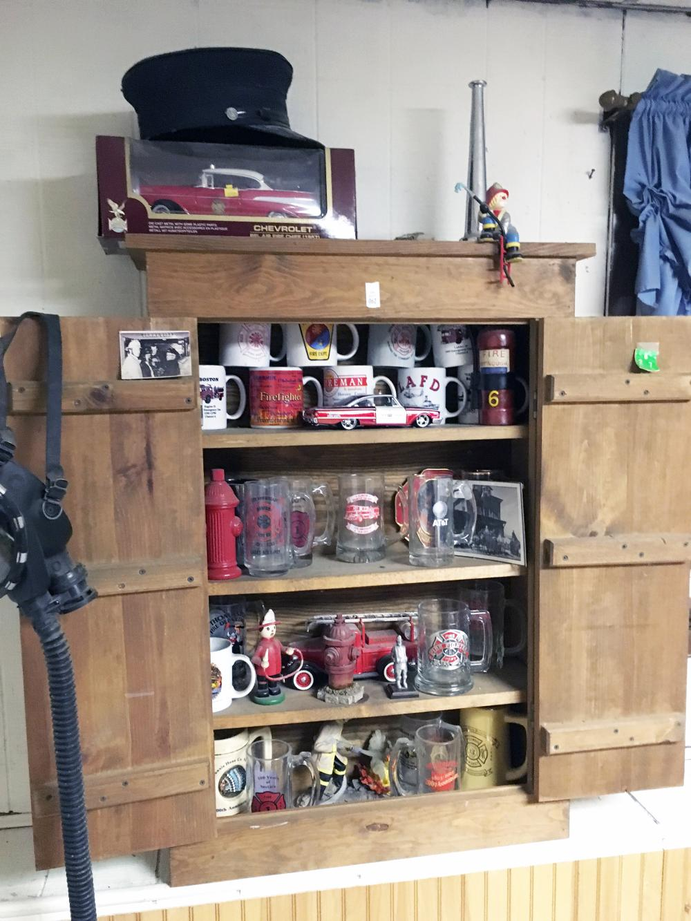Fireman Collectibles and Cabinet