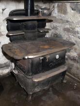 Lot 138: Antique Palace Crawford Wood Burning Stove