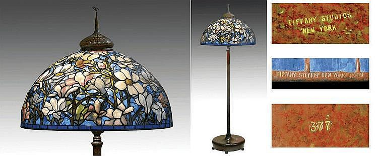 AN IMPORTANT TIFFANY STUDIOS 'MAGNOLIA' LEADED GLASS AND BRONZE FLOOR LAMP