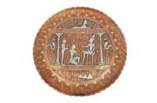 AN EGYPTIAN SILVER INLAID COPPER PLATE
