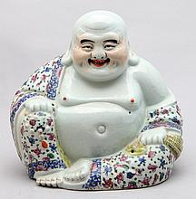 A PORCELAIN SCULPTURE MODELED IN THE FORM OF THE LAUGHING BUDDHA