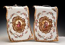 A PAIR OF HANGING PORCELAIN PLAQUES