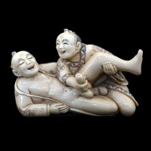 A JAPANESE CARVED IVORY EROTIC MALE NETSUKE