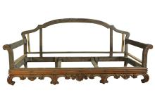 A FRENCH CARVED WOOD THREE SEAT SOFA FRAME