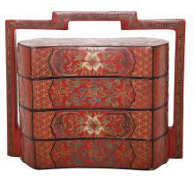 A CHINESE RED LACQUER THREE TIERED WEDDING BOX
