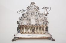 A SILVER GERMAN STYLE HANUKKAH LAMP