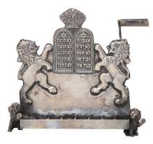 A SILVER MINIATURE HANUKKAH LAMP
