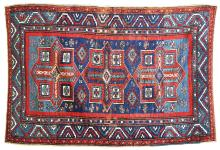 AN ANTIQUE KAZAKH CAUCASIAN RUG