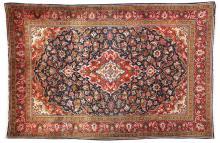 AN OLD PERSIAN SAROUK RUG