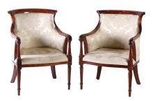A PAIR OF EMPIRE STYLE LIBRARY ARMCHAIRS