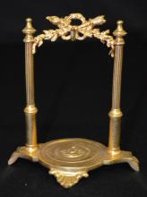 Antique Metal Pocket Watch Holder in the Form of an Arch with 2 Side Pillars, a top garland of leaves, wreath, torch and arrow quiver; the base is round with side feet the pillars stand on.  5 3/8