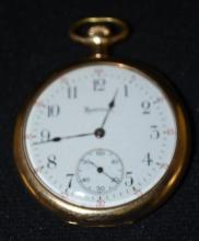 Hamilton 910 17J 12S OF DMK Swing Out No. 1854955 Pocket Watch: With a good SSD. In a yellow 25 Year Hamilton No. 10376414 multi-hinged case with a large fancy monogram on the back. The watch is running at this time. Sells as is, where is.