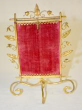 Antique Fire Screen Pocket Watch Holder: With a metal wire frame with a floral and leaf border and a velvet back panel in the shape of a fire screen. 6 5/8