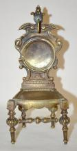 Antique Cast Metal Pocket Watch Holder in the Form of a Chair: All metal with ornate legs and back and a winged crest, unmarked. 5 1/2
