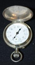 Double Faced, Pin Set, Stem Wound Pocket Watch: One face has Roman Numerals and the other has Standard Numbers. It is about a Size 12 or 14. The movement was not accessed. In a White No. 1905 case.