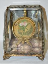 Antique Beveled Glass Pocket Watch Holder and Protector w/Brass Trim: There is tufted purple silk flooring and a mirrored back. The slanted front door opens downward to reveal the watch holder and chain supports.