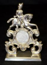 Antique Nickel Plated Pocket Watch Holder in the Form of a Highlander on a Horse: The man and his horse sit on a scroll work base with a hook coming out the side of the horse. 5 3/4