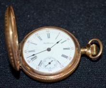 Antique 14K American Waltham 7J 0S DMK Stem Wound Hunting Case Pocket Watch No. 9344515: In a yellow U.S. Assay 14K hunting case No. 82421. There is a large monogram on the back of the case.