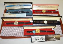 5 Wrist Watches in Boxes: 1.) Centennial w/S. Korean movement. 2.) Helbros, stem wind. 3.) Motocraft Quartz. 4.) Swiss Cronel No. 675 and Day of Month at 3. 5.) Swiss Cronel No. 675, all gold color, w/Day of Month at 3.