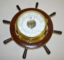 Germany Ship's Wheel Compensated Precision Barometer: With an enamel dial, a brass case, and a wood ship's wheel. Has not been tested. Sells as is, where is. Overall Diameter - 13