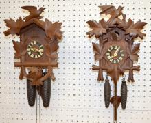 2 German Black Forest Carved Cuckoo Clocks: The movements are marked; the cases have carved birds and leaves, the pendulums and 2 weights. Both sell as is, where is.