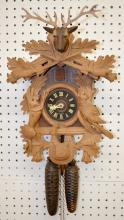 German Black Forest Carved Cuckoo Clock with Deer Head and Hanging Game: The movement is signed