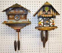 2 German Cuckoo Clocks, Painted Cottages, 1 with a Swiss Music Box: 1.) Musical, plays