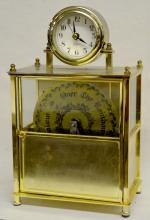 Quartz B.O. Brass Musical Desk Clock: The quartz clock sits on a battery operated box that should play a record. Sells as is, where is. 11