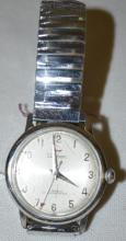 Waltham 17J Men's Wrist Watch with a Stretch Band and in a Waltham Stainless Case. The watch is running at this time. Sells as is, where is.