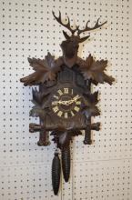 German Black Forest Carved Cuckoo Clock with Deer Head: The movement is marked
