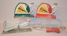 Four Antique Egg Scales: 1.) Brower Mfg. Quincy, Illinois; green a w/colorful decal.; 2.)