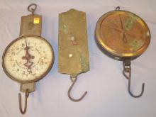 2 Antique Milk Scales and One 30 Pound Brass Hanging Scale: 1.) Pelouze 60 lb. dairy scale.; 2.) Chatillon 40 lb. copper and metal milk scale.; 3.) C. Forschners 30 lb. brass and metal spring balance scale. The brass one is 11