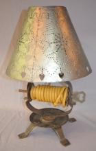 Iron Rope Candle Lamp with Pierced Tin Shade: It has a 4-footed iron base, a center key spindle that holds the rope candle, a pierced tin shade decorated with tulips, flowers and hearts. NOT ANTIQUE. 15