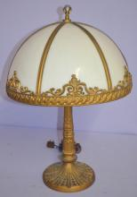 Vintage 6 Panel Opaque Glass Electric Table Lamp, Unsigned: With a molded, metal 12 panel floral base, 2 lights with pull chains, a metal framed shade with a ribbed border and scroll decoration.