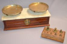 Antique Counter Top Marble Top Scale with Weights: It has a wood base, a marble top, brass colored pans and 8 brass weights from 1 ounce to 2 pounds in a fitted wood frame. 8