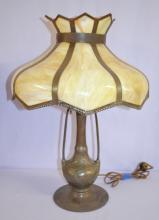 16 Panel Caramel Slag Glass Electric Table Lamp: It has a metal base with molded leaves and open arms. There are 2 light sockets with pull chains. The shade has a simple metal trim on it. Has not been tested. 22