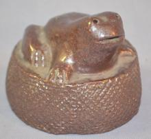 Lehigh Pottery Frog Paperweight, Signed with a Diamond and Lehigh: With a round, tree trunk like base with a frog top. It is brown glaze on red pottery. 3 5/8