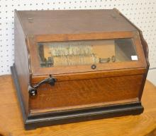 Antique Oak Concert Roller Organ and 19 Organ Rolls: The case has the original stenciling. It winds up okay but does not play. 12 1/4