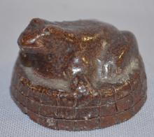 Lehigh Pottery Frog Paperweight, Marked with Diamond and Lehigh: It is made with a brown glaze on red pottery. 1 1/2