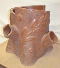 Folk Art Sewer Pottery Tile Tree Trunk Yard Urn: Unsigned, hand made to look like a tree trunk with bark, branch stubs and a cut down top. The artist also added a floral design on the outside. Made with red pottery tile. The bottom is open, as made.