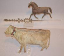 2 Primitive Metal Weathervane Animals, Trotting Horse and Milk Cow: 1.) The horse is hollow and is mounted on a wind indicator with an iron spear shape on one end and twisted wire on the other.; 2.) The milk cow is also hollow and is unmarked.