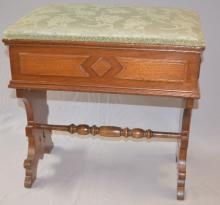 Antique Lift Top Slipper Bench: With carved wood legs, stretcher and decoration. It has an upholstered top that lifts for storage. 17 3/4