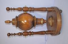 Wooden Bingo Shaker on Keno Ball Drop: W/round wooden platform on bun feet. There are 2 carved spindles w/carved hollow fixture between them - it swings to shake the balls or numbers. It is unmarked. 21 1/2