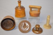 6 Antique Wooden Butter Presses: 1.) 2 piece w/oak leaf and acorns; 2.) 2 piece pineapple; 3, 4, & 5.) Are all fern leaf shaped with a knob handle; 6.) 1 piece, a thin straight line and a bar handle. Tallest - 6