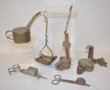 6 Primitive Lighting Implements: Includes Candle Wick scissors, 3 Betty lamps and a Fuel Can. All are in used condition. Tallest - 6