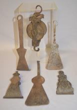 6 Antique Primitive Tools and Utensils: 1.) 2 decorative iron hanging paper clips, 1 marked Tatum.; 2.) Early Hoop Skirt Measurer, cast iron with a brass strap pulley, marked