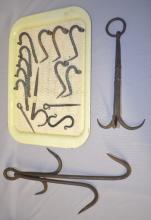 16 Hand Made Hooks for Utensils, Tools, Pots and Pans: Includes 2 straight spikes; S curve; 1 straight spike with a curled hook; 5 short spikes; 5 with flat nail holes; a large iron treble hook and a large 4 hook tool with spaced out hooks.