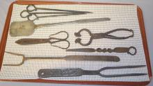 10 Early Primitive Tools and Utensils: Includes a large cast iron granny fork; a 2 prong meat fork; a twisted spike; scissors; 3 skewers; a steel spatula and 2 pair of spring loaded floral cutters.