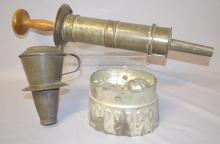 3 Early Primitive Tin Kitchen Tools and Pans: 1.) Tin hand held sausage stuffer with wooden plunger.; 2.) Tin mold with rose design.; 3.) Tin fine screen strainer with flip lid and rim to hold onto a container. Longest - 20