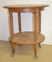 Antique Oak 2 Tier Parlor Table with Twisted Legs and Claw and Ball Feet: It has 4 legs and a full round stretcher shelf. The feet are metal claw and glass balls. 28
